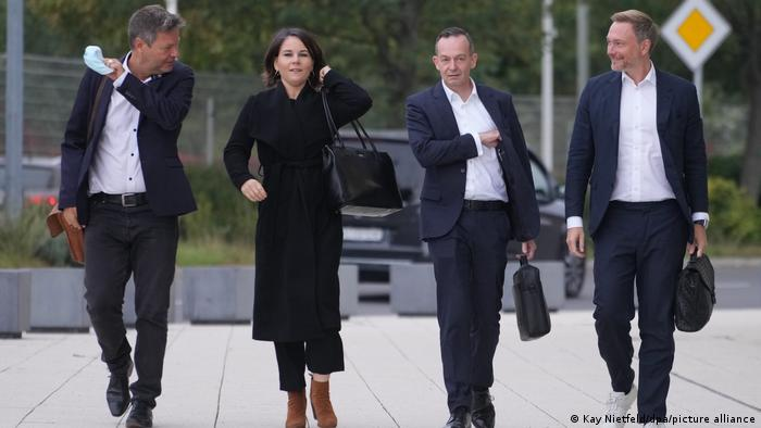 (l to r) Robert Habeck, Annalena Baerbock (Greens), Volker Wissing and Christian Lindner (FDP) arrive for coalition talks in Berlin