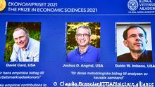 From left, on the screen are the winners of the 2021 Nobel prize for economics; David Card of the University of California at Berkeley; Joshua Angrist from the Massachusetts Institute of Technology; and Guido Imbens from Stanford University, announced during a press conference at the Royal Swedish Academy of Sciences, in Stockholm, Sweden, Monday, Oct. 11, 2021. (Claudio Bresciani/TT via AP)