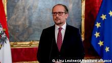 The new Austrian Chancellor Alexander Schallenberg is sworn-in by Austrian President Alexander Van der Bellen (not in the picture) in the presidential chancellery in Vienna, Austria, Monday, Oct. 11, 2021. (AP Photo/Lisa Leutner)