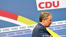 The leader of Germany's conservative Christian Democratic Union (CDU) party and candidate for Chancellor Armin Laschet leaves the stage after giving a statement in Berlin on October 7, 2021. - The beleaguered chief of Germany's CDU party signalled that he was ready to step aside as leader of the conservatives, after an election debacle that has left them on the brink of the opposition. (Photo by Tobias Schwarz / AFP)