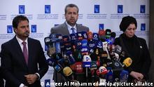 11.10.2021, Bagdad. Jaleel Adnan Khalaf (M), Richter und Vorsitzender der Unabhängigen Hohen Wahlkommission des Irak, spricht während einer Pressekonferenz nach den irakischen Parlamentswahlen. Unter einem Großaufgebot an Sicherheitskräften hat im Irak am Sonntag (10.10.2021) die Parlamentswahl stattgefunden. +++ dpa-Bildfunk +++