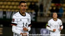 Germany's Jamal Musiala celebrates after scoring his side's fourth goal during the World Cup 2022 group J qualifying soccer match between North Macedonia and Germany at National Arena Todor Proeski stadium in Skopje, North Macedonia, Monday, Oct. 11, 2021. (AP Photo/Boris Grdanoski)