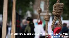 August 28, 2021, London, United Kingdom: An installation of hanging noose and red flower at Whitehall drawing attention to the 1988 Massacre of the Political Prisoners in Iran..A demonstration organised by supporters of the National Council of Resistance of Iran (NCRI) to protest against the inauguration of Iran's new president Ebrahim Raisi whom they accuse of being responsible for the mass execution of thousands of NCRI members in 1988 at Whitehall. The NCRI also called for the UK government to impose sanctions against Iran's leadership. (Credit Image: © Loredana Sangiuliano/SOPA Images via ZUMA Press Wire