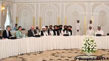 12.10.2021, Doha, Qatar, Taliban delegates meet with U.S. and European delegates in Doha, Qatar October 12, 2021. REUTERS/Stringer. NO RESALES. NO ARCHIVES.