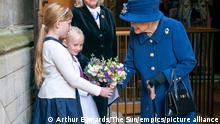 Centenary of the Royal British Legion. Queen Elizabeth II is presented with a bouquet of flowers as she arrives to attend a Service of Thanksgiving at Westminster Abbey in London to mark the Centenary of the Royal British Legion. Picture date: Tuesday October 12, 2021. See PA story ROYAL Queen . Photo credit should read: Arthur Edwards/The Sun/PA Wire URN:63016073