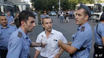 Russian police detain prominent rights activist Lev Ponomaryov during an unsanctioned rally