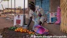 In a village market in South Sudan, a woman sells fruits and vegetables to make a living. Resilient food systems contribute to peacebuilding by strengthening livelihood security. In conflict areas, in particular, local markets, therefore, play an important role in dealing with the consequences of a conflict. ***Fotos nur im Welthungerhilfe Kontext nutzen und nicht an Dritte weitergegeben! Bilder muessen mit dem Credit Copyright ?Fotograf?/Welthungerhilfe versehen werden. These pictures are the property of Welthungerhilfe and must be used in the context of We