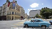HAVANA, CUBA - JULY 15: A classic car travels through one of the streets of Havana. The Cuban government announced on Wednesday, July 14, the first package of measures to appease the population, among them the free import of food and medicines, after three days of unprecedented protests, Cuba on July 15, 2021. Yander Zamora / Anadolu Agency