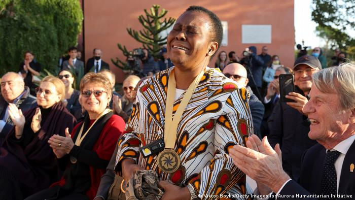 Julienne Lusenge cries as she as announced as the winner of the Aurora Prize