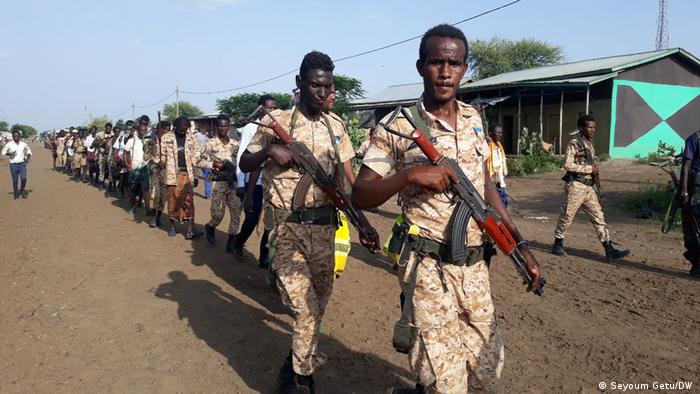 Soldiers marching with weapons in Ethiopia's Afar region