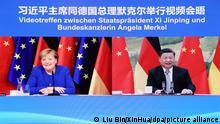 (211013) -- BEIJING, Oct. 13, 2021 (Xinhua) -- Chinese President Xi Jinping meets with German Chancellor Angela Merkel via video link in Beijing, capital of China, Oct. 13, 2021. (Xinhua/Liu Bin)