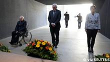 Germany's President Frank-Walter Steinmeier, Parliament President Wolfgang Schaeuble and Defence Minister Annegret Kramp-Karrenbauer attend a wreath-laying ceremony at the Bundeswehr Memorial to honour those involved in Germany's 20-year Afghanistan mission, in Berlin, Germany, October 13, 2021. Sebastian Wilke/Bundeswehr/BMVG (German Federal Ministry of Defence)/Handout via REUTERS THIS IMAGE HAS BEEN SUPPLIED BY A THIRD PARTY. NO RESALES. NO ARCHIVES