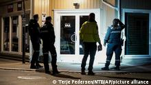 Police investigate an arrow stuck in a wall after an attack in Kongsberg, Norway, Wednesday, Oct. 13, 2021. A man armed with a bow and arrows killed several people Wednesday near the Norwegian capital of Oslo before he was arrested, authorities said. (Terje Pedersen/NTB via AP)
