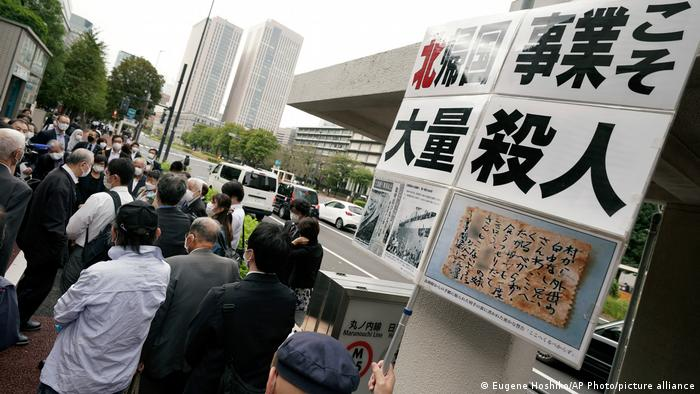 Plaintiffs and their supporters gather to walk toward the Tokyo District Court