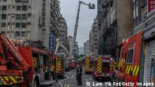 14.10.2021 KAOHSIUNG, TAIWAN - OCTOBER 14: A firefighter searches for victims from a residential building in the wake of a fire on October 14, 2021 in Kaohsiung, Taiwan. Additional deaths are feared as at least 14 were confirmed dead after a residential building fire in the southern Taiwanese city, United Daily News reported. (Photo by Lam Yik Fei/Getty Images)