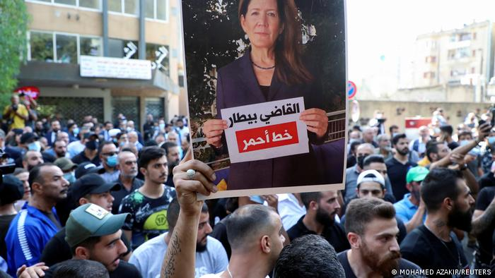 A supporter of Hezbollah holds up a picture of US Ambassador to Lebanon Dorothy Shea during a protest against Judge Tarek Bitar