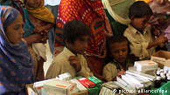 Flood victims receive medical treatment at a camp in Karachi