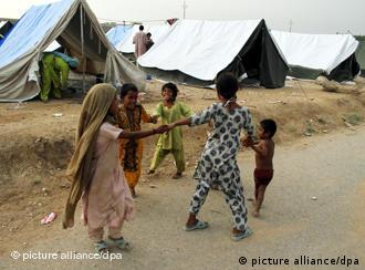 Children play at a tent camp for flood victims in Razaqabad on the outskirts of Karachi