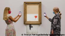 LONDON, ENGLAND - SEPTEMBER 03: Banksy's Love is in the Bin (2018) is installed at Sotheby's on September 03, 2021 in London, England. Banksy's Love is in the Bin (est. £4 - 6 million) will go on public view this weekend for a special two day-view at Sotheby's New Bond Street Galleries, before embarking on a global tour ahead of the Contemporary Art Evening Auction at Sotheby's London on October 14. (Photo by Tristan Fewings/Getty Images for Sotheby's)