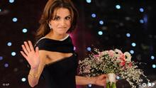Queen Rania Al Abdullah of Jordan waves to the audience after making an appearance at the Festival di Sanremo Italian song contest at the Ariston theater in San Remo, Italy, Wednesday, Feb. 17, 2010. (AP Photo/Alberto Pellaschiar)