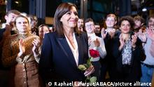 Paris Mayor and Socialist Party (PS) candidate for the 2022 French presidential election Anne Hidalgo hold a red rose as she acknowledges the applause during the result of the vote of the PS militants to designate their candidate for the presidential election in Paris on October 14, 2021. Hidalgo was nominated late on October 14, 2021, by the Socialist Party to run for the 2022 French presidential election. Photo by Raphael Lafargue/ABACAPRESS.COM