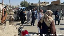 KANDAHAR, AFGHANISTAN - OCTOBER 15: People gather at the scene after a bomb blast hits Shia community mosque in Afghanistan's southern Kandahar province on October 15, 2021 Murteza Khaliqi / Anadolu Agency