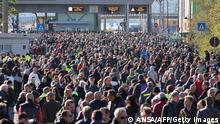 This photo obtained from Italian news agency Ansa shows dockers and port workers gathering for a protest in the port of Trieste, Friuli Venezia Giulia, on October 15, 2021 as new coronavirus restrictions for workers come into effect. - Italy braced for nationwide protests, blockades and potential disruption on October 15, 2021 as all workers must show a so-called Green Pass, offering proof of vaccination, recent recovery from Covid-19 or a negative test, or face being declared absent without pay. - Italy OUT (Photo by STRINGER / ANSA / AFP) / Italy OUT (Photo by STRINGER/ANSA/AFP via Getty Images)