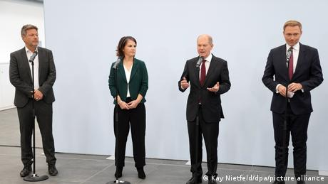 The leaders of the SPD, Greens and FDP
