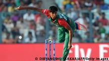 Bangladesh's Mustafizur Rahman bowls during the World T20 cricket tournament match between Bangladesh and New Zealand at The Eden Gardens Cricket Stadium in Kolkata on March 26, 2016. Mustafizur Rahman took five wickets to help Bangladesh restrict New Zealand to 145 for eight as they chased a consolation victory at cricket's World Twenty20 in Kolkata. / AFP / Dibyangshu SARKAR (Photo credit should read DIBYANGSHU SARKAR/AFP via Getty Images)