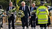 British Prime Minister Boris Johnson, Leader of the Labour Party Keir Starmer, left, followed by Speaker of the House of Commons Lindsay Hoyle, and Home Secretary Priti Patel carry flowers as they arrive at the scene where a member of Parliament was stabbed Friday, in Leigh-on-Sea, Essex, England, Saturday, Oct. 16, 2021. David Amess, a long-serving member of Parliament was stabbed to death during a meeting with constituents at a church in Leigh-on-Sea on Friday, in what police said was a terrorist incident. A 25-year-old man was arrested in connection with the attack, which united Britain's fractious politicians in shock and sorrow. (AP Photo/Alberto Pezzali)