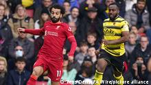 16.10.2021, Watford***** Watford v Liverpool - Premier League - Vicarage Road. Liverpool's Mohamed Salah (left) and Watford's Danny Rose battle for the ball during the Premier League match at Vicarage Road, Watford. Picture date: Saturday October 16, 2021. See PA story SOCCER Watford. Photo credit should read: Tess Derry/PA Wire. RESTRICTIONS: EDITORIAL USE ONLY No use with unauthorised audio, video, data, fixture lists, club/league logos or live services. Online in-match use limited to 120 images, no video emulation. No use in betting, games or single club/league/player publications. URN:63087204