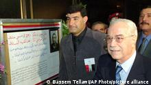 Syrian Defense Minister Mustafa Tlas, right, flanked by member of parliament Medhat Saleh at the opening of an exhibition for jailed Syrian artist Assem al-Wili on Sunday, March 26, 2000, in Damascus. Al-Wili, from the Israeli-occupied Golan Heights, was sentenced in Israel to 27 years in jail and has already served 15 years. Syrian President Hafez Assad met U.S. President Bill Clinton in Geneva Sunday, for talks on the stalled Syrian-Israeli peace talks in which Syria seeks to recover the Golan Heights. (AP PHOTO/Bassem Tellawi).