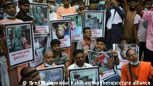 Hindu people from various organizations protest at Shahabag in Dhaka, Bangladesh on October 16, 2021. As they demand justice for the attacks on Durga Puja Mandaps across the country that occurred within the last few days. (Photo by Syed Mahamudur Rahman/NurPhoto)