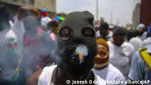 FILE - In this July 26, 2021 file photo, a member of the gang led by Jimmy Cherizier, alias Barbecue, a former police officer who heads a gang coalition known as G9 Family and Allies,¨ joins a march to demand justice for slain Haitian President Jovenel in Lower Delmas, a district of Port-au- Prince, Haiti. Haiti's government warned Monday, Sept. 6, 2021, about a spike in kidnappings and other crimes as it pledged to fight gangs that in response to the looming crackdown are threatening police with greater violence as the country braces for more instability. (AP Photo/Joseph Odelyn, File)