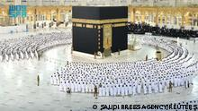 Pilgrims perform the Fajr prayer without social distancing, after Saudi authorities announced the easing of coronavirus disease (COVID-19) restrictions, at the Grand Mosque in holy city of Mecca, Saudi Arabia, October 17, 2021. Saudi Press Agency/Handout via REUTERS ATTENTION EDITORS - THIS PICTURE WAS PROVIDED BY A THIRD PARTY