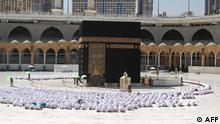 The Grand Mosque in the holy Saudi city of Mecca is operating at full capacity on October 17, 2021, with worshippers praying shoulder-to-shoulder for the first time since the coronavirus pandemic began. (Photo by - / AFP)