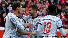 LEVERKUSEN, GERMANY - OCTOBER 17: Robert Lewandowski of FC Bayern Muenchen celebrates with team mates after scoring their side's second goal during the Bundesliga match between Bayer 04 Leverkusen and FC Bayern München at BayArena on October 17, 2021 in Leverkusen, Germany. (Photo by Lukas Schulze/Getty Images)