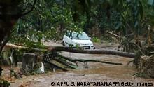 A car stucked in mud waters is pictured after flash floods caused by heavy rains at Thodupuzha in India's Kerala state on October 16, 2021. (Photo by Appu S. Narayanan / AFP) (Photo by APPU S. NARAYANAN/AFP via Getty Images)