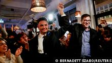 Budapest's Mayor Gergely Karacsony and opposition candidate for prime minister Peter Marki-Zay cheer with supporters at the election headquarters after the opposition primary election in Budapest, Hungary, October 17, 2021. REUTERS/Bernadett Szabo