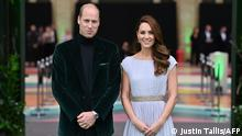 Britain's Prince William, Duke of Cambridge, (L) and Britain's Catherine, Duchess of Cambridge, (R) arrive on the green carpet to attend the inaugural Earthshot Prize awards ceremony at Alexandra Palace in London on October 17, 2021. - The Earthshot Prize honours five inaugural winners with an award of £1 million ($1.4 million, 1.2 million euros) each to pursue solutions to the world's greatest environmental problems at a glitering gala ceremony. Prince William, Duke of Cambridge, launched the prestigious Earthshot Prize in October 2020 and hopes that the event will help propel the fight against climate change leading up to the COP26 summit in Scotland, calling those on the shortlist innovators, leaders and visionaries. (Photo by JUSTIN TALLIS / AFP)