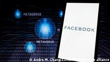 September 27, 2021, Asuncion, Paraguay: Illustration photo - Logo of Facebook company is displayed on a smartphone backdropped by visual representation of metaverse. Facebook has announced a $50 million fund that it says will help it develop the metaverse more responsibly. Facebook describes metaverse as ''a set of virtual spaces where you can create and explore with other people who aren't in the same physical space as you'', spread out over a variety of products and services. (Credit Image: © Andre M. Chang/ZUMA Press Wire