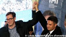 Conservative independent candidate Peter Marki-Zay, right, celebrates with Budapest's Mayor Gergely Karacsony in Budapest, Hungary, Sunday, Oct. 17, 2021, after he won an opposition primary race in Hungary, making him nominee of a six-party opposition coalition who will lead a challenge to right-wing populist Prime Minister Viktor Orban in national elections next spring . (AP Photo/Laszlo Balogh)