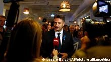 Conservative independent candidate Peter Marki-Zay talks with the media in Budapest, Hungary, Sunday, Oct. 17, 2021, after he won an opposition primary race in Hungary, making him nominee of a six-party opposition coalition who will lead a challenge to right-wing populist Prime Minister Viktor Orban in national elections next spring. (AP Photo/Laszlo Balogh)