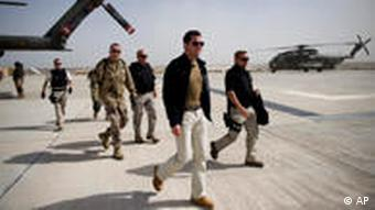 Guttenberg walks away from a plane in Afghanistan