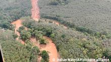 This photograph provided by the Indian Navy and taken from a naval helicopter shows the scene after a landslide triggered by heavy rains in the western ghats mountains at Koottickal in Kottayam district, southern Kerala state, India, Sunday, Oct.17, 2021. Bodies of six people have been recovered, and rescuers are searching for those feared missing. (Indian Navy via AP)
