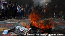 An effigy of President Nayib Bukele is set on fire by demonstrators during an anti-government protest in San Salvador, El Salvador, Sunday, Oct. 17, 2021. (AP Photo/Salvador Melendez)