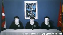 epa02973987 Image taken from the digital edition of the Basque nationalist newspaper Gara shows three ETA hooded members while they read a statement in which they announced their definitive halt to violence, on 20 October 2011. After nearly fifty years of violence in the Basque Country, the terrorist group ETA declared a unilateral end to its campaign of bombings and shootings, saying it wished to seize 'an historical opportunity to reach a just and democratic resolution' of the conflict. EPA/JAVIER ETXEZARRETA