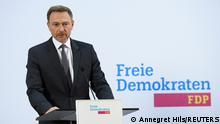 Germany's Free Democratic Party (FDP) leader Christian Lindner gives a statement after a board meeting that approved coalition talks with the Social Democratic Party (SPD) and the Greens according to a party source, in Berlin, Germany, October 18, 2021. REUTERS/Annegret Hils