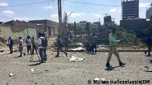 Civilians survey the destruction in Mekele