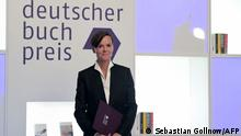Antje Ravik Strubel, author of the novel Blaue Frau (Blue woman) poses on stage after being awarded with the German Book Prize 2021 in Frankfurt am Main, western Germany, on October 18, 2021. - Antje Ravik Strubel received the award for her novel Blaue Frau on October 18, 2021. The prize was awarded at the start of the Frankfurt Book Fair, which opens on October 19 evening. The German Book Prize is awarded for the best German-language novel and is worth a total of 37 500 euros. (Photo by Sebastian Gollnow / POOL / AFP)